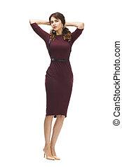 Beautiful woman in a vinous knitted dress - Portrait in full...
