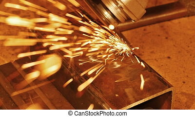Sparks. Metalworking close-up. Slow