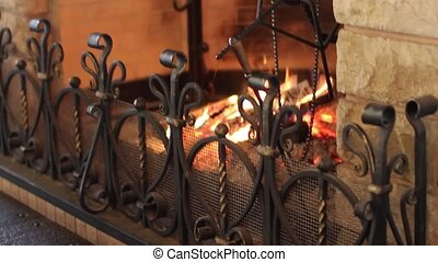 Forged grating fireplace in a country house
