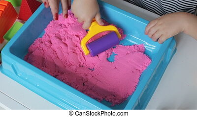 Mother with Kinetic Sand - Mother and her little daughter...