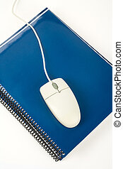 Blue school textbook and computer mouse