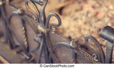 Forged grating fireplace in a country house - Burning...