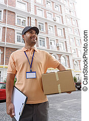 Young man making home delivery - Always professional and on...