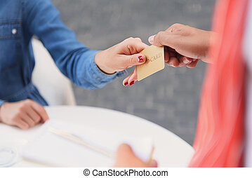 Customer paying by card in cafe