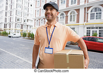 Young man making home delivery - Fast and efficient service....