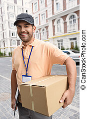 Young man making home delivery - Your parcel is safe with...