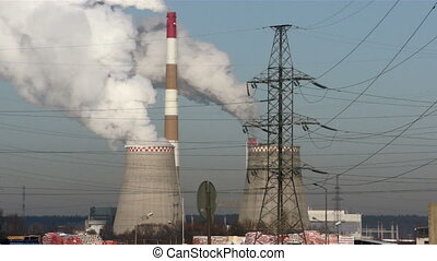 Factory with smoke stacks - Smoke stacks of factory in...