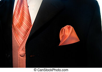 Groom\'s Garb - Peach colored accessories accenting a black...