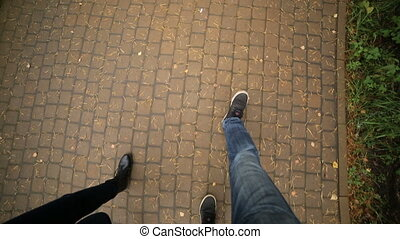 feet men and female top blue jeans and sneakers is a red...