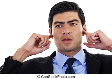 Hear no Evil - Stock image of businessman covering his ears...