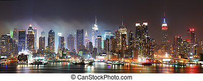 New York City Manhattan skyline panorama at night over...