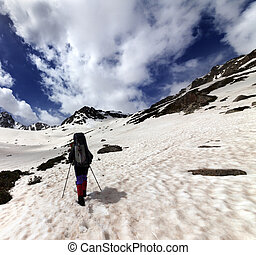 Hiker in snow mountain at sun day