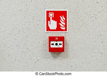 Red fire alarm button installed on the wall