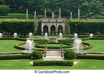 Fountains in garden with green lawn from Longwood Garden,...