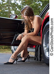 Armed Spy Girl Exits Sports Car - Sexy leggy spy girl with...