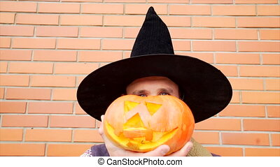 Young man with Jack latern pumpkin