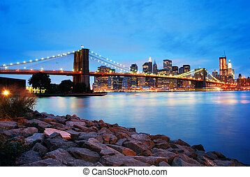 Brooklyn Bridge and Manhattan skyline in New York City over...