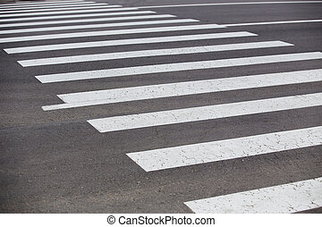 crosswalk on the road - white lines of crosswalk on...
