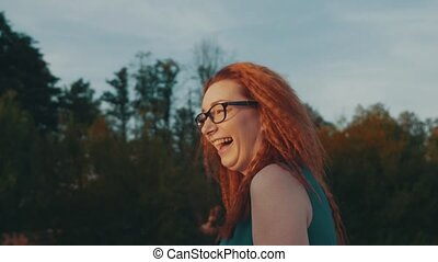 Red hair girl in glasses on motor boat. Beautiful summer...