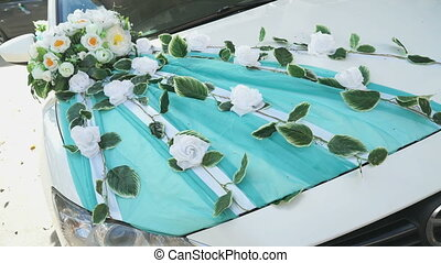 Wedding decoration on a white hood car outdoors - Wedding...
