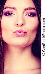 Closeup young woman face kissing - Closeup young woman face...