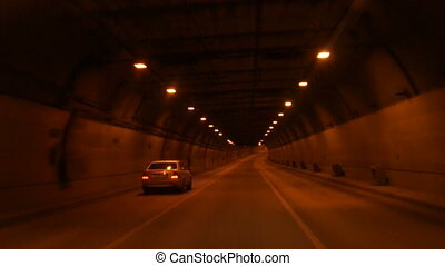 Tunnel road at night.
