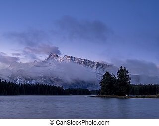 Rundle Mountain reflecting in Two Jack Lake in Banff...