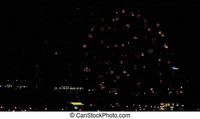 Fireworks over night city - Colorful fireworks at holiday...