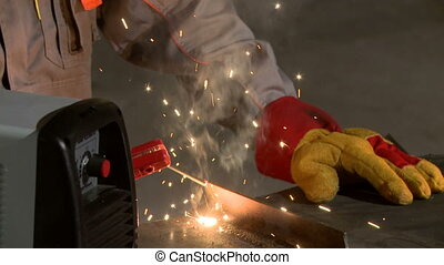 View of man in boiler suit with working tool