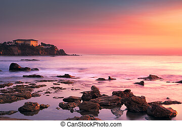 Castiglioncello old building on the rocks and sea on sunset....