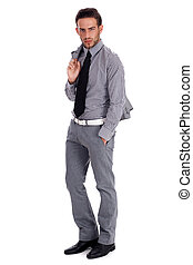 Smart business man standing with his suit over white...
