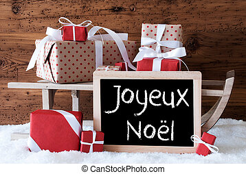 Sleigh With Gifts On Snow, Joyeux Noel Means Merry Christmas...