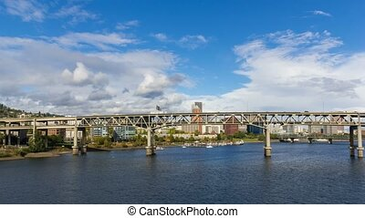 Time lapse of clouds and auto traffic on Marquam bridge along Willamette River in downtown Portland OR