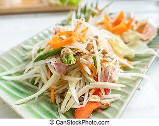 Papaya salad or Som tum, Thai food on table