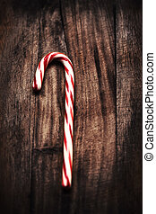 Christmas Mint hard candy cane striped over wooden dark...