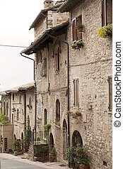 Assisi, Italy - Medieval street in Assisi, Italy. Assisi is...