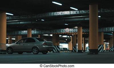 Huge underground parking. - Motion shot of huge underground...