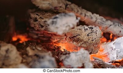 live coals in a fireplace, flames and burning woods