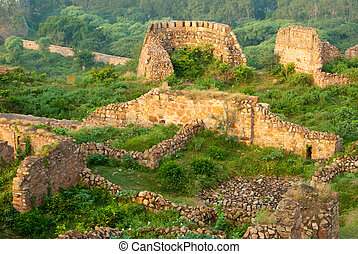 Delhi - The ruins of the Tughlaqabad Fort in New Delhi,...