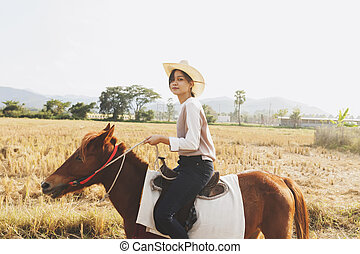 Woman smiling with relax time on small horse - Beautiful...
