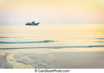 Dreamy sunset seascape - Traditional fishing boats in the...