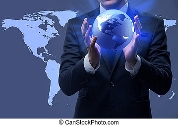 Businessman holding globe in global business concept
