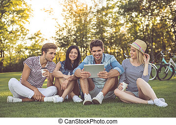 Friends resting in park - Beautiful stylish friends are...