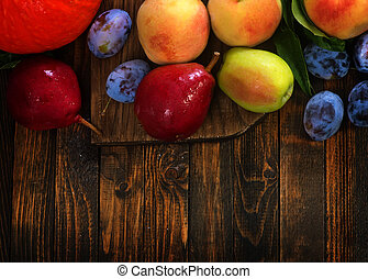 autumn fruits on the wooden table, harvest on a table