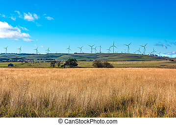 Windmill electricity turbine with rural outback background....