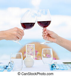 wine toasting - Couple drinking wine in romantic dinner on...
