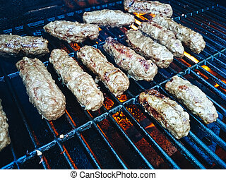 Mince rolls cevapcici on the grill, top view