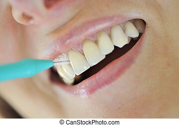 A Woman Cleaning Her Teeth - Interdental brush- Woman...