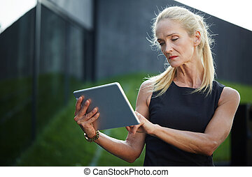 Busy businesswoman checking informations - Close up portrait...