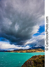 Giant cloud over lake Pehoe - A giant cloud over the...
